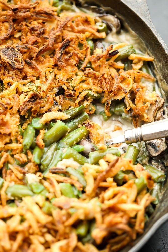 close up of vegan green bean casserole in black pan