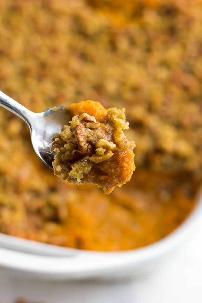 vegan sweet potato casserole with a bit on a spoon