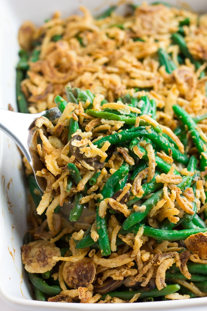 vegan green bean casserole on a silver spoon