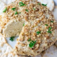 vegan cheeseball with crackers around it