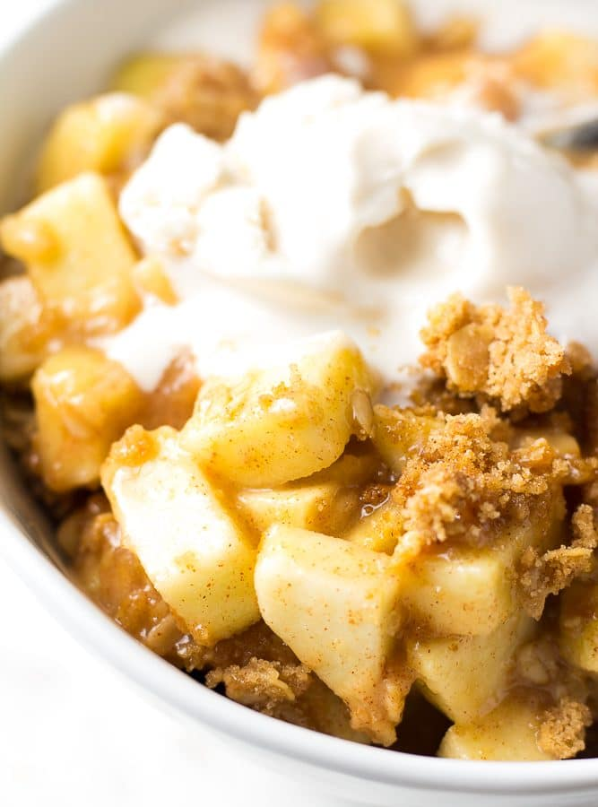 close up shot of vegan apple crisp with soy vanilla ice cream