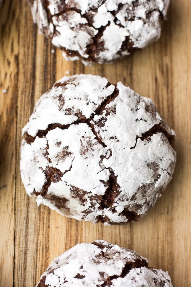 vegan chocolate crinkle cookies on wood board