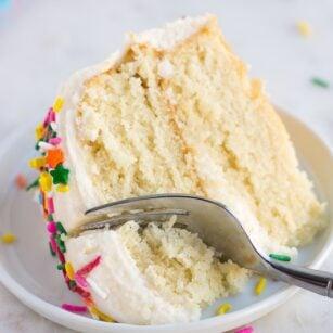 piece of vegan vanilla cake on a plate