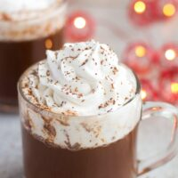 vegan hot chocolate with coconut whip cream in a cup