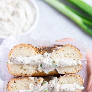bagel cut in half with vegan cream cheese in it