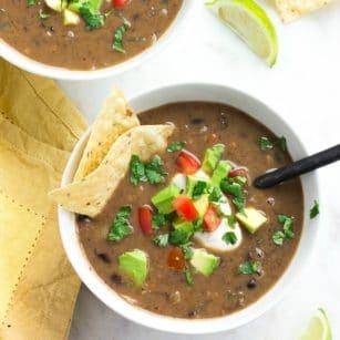 square image of two bowls of vegan black bean soup