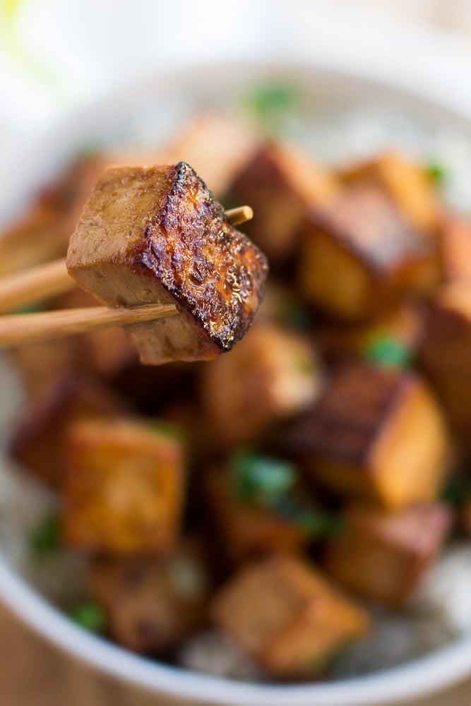 marinated tofu piece on a chopstick