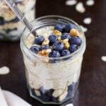 jar of vegan overnight oats with blueberries and walnuts