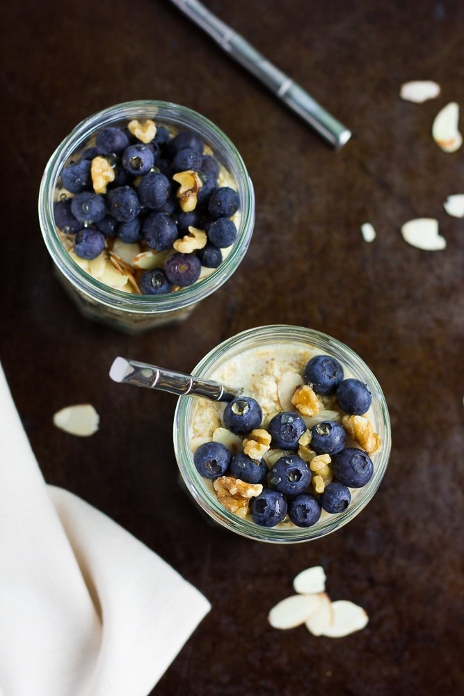 jar of vegan overnight oats with blueberries and walnuts from the top