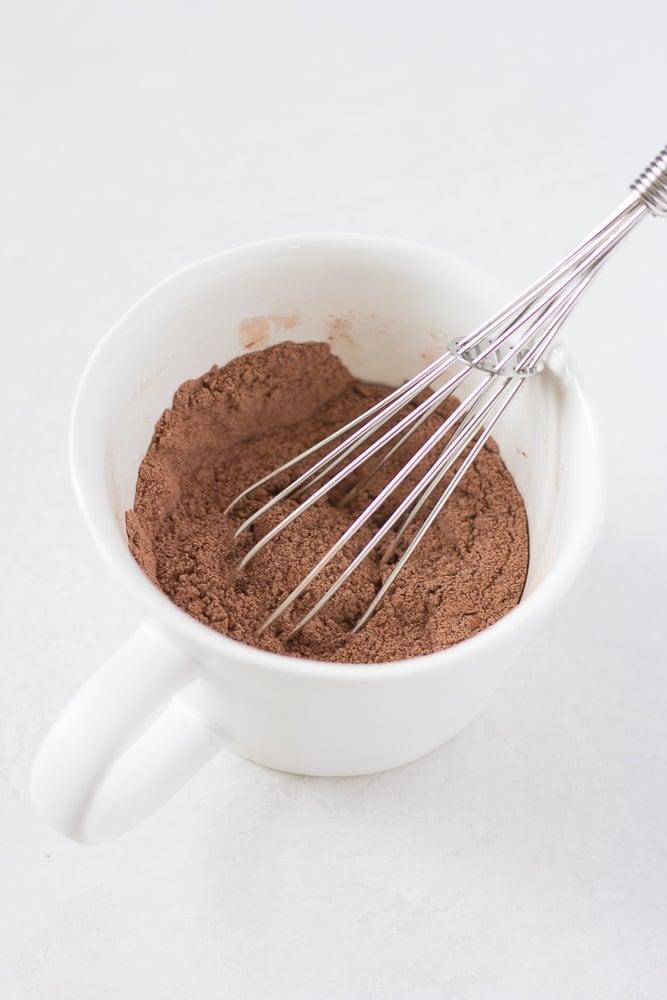 dry ingredients whisked in a mug for vegan mug cake