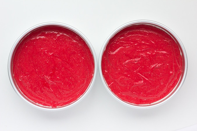 red velvet cake batter in two pans