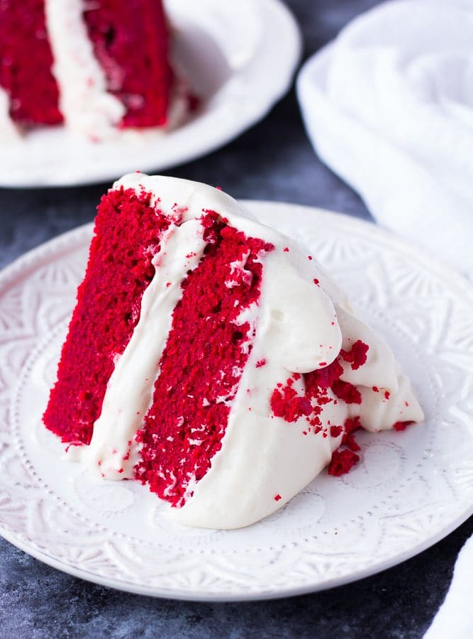 slice of vegan red velvet cake on a plate