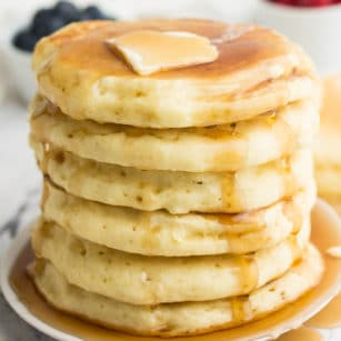 square image of stack of vegan pancakes with syrup and butter on top
