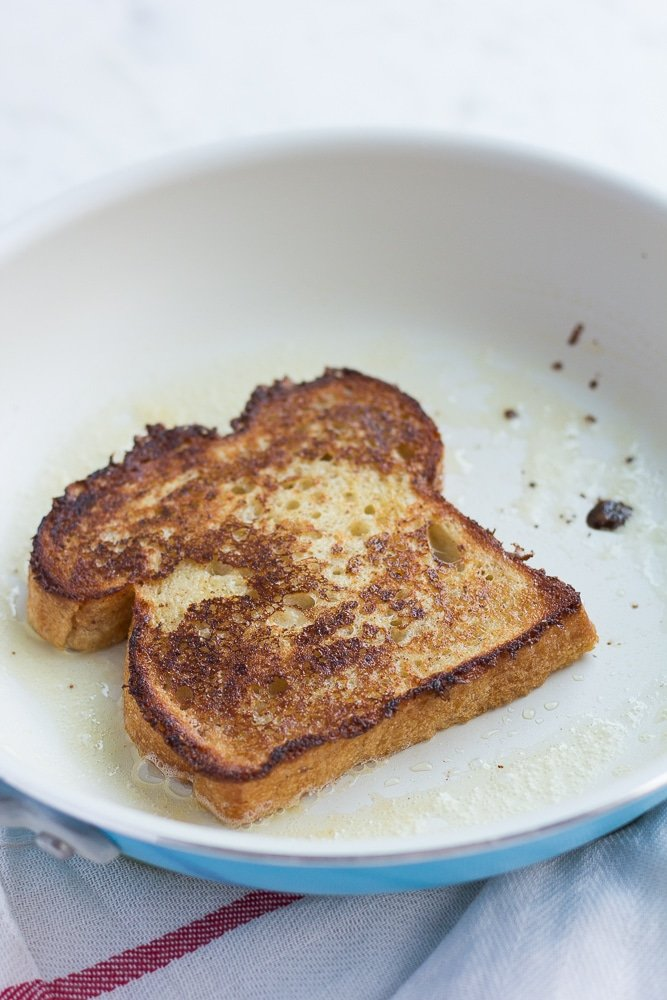 vegan french toast being cooked in a pan.