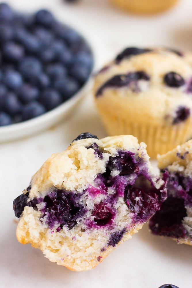 vegan blueberry muffin cut in half to show insides