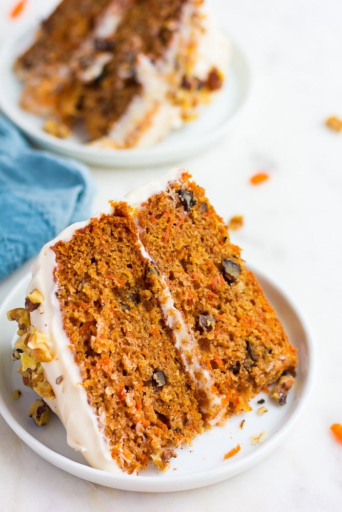 piece of vegan carrot cake on a white plate