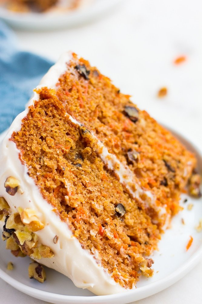 close up piece of vegan carrot cake on a white plate