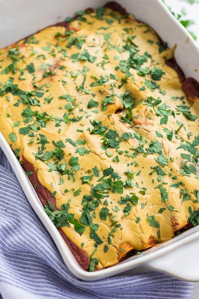 whole pan of vegan enchiladas with cilantro on top