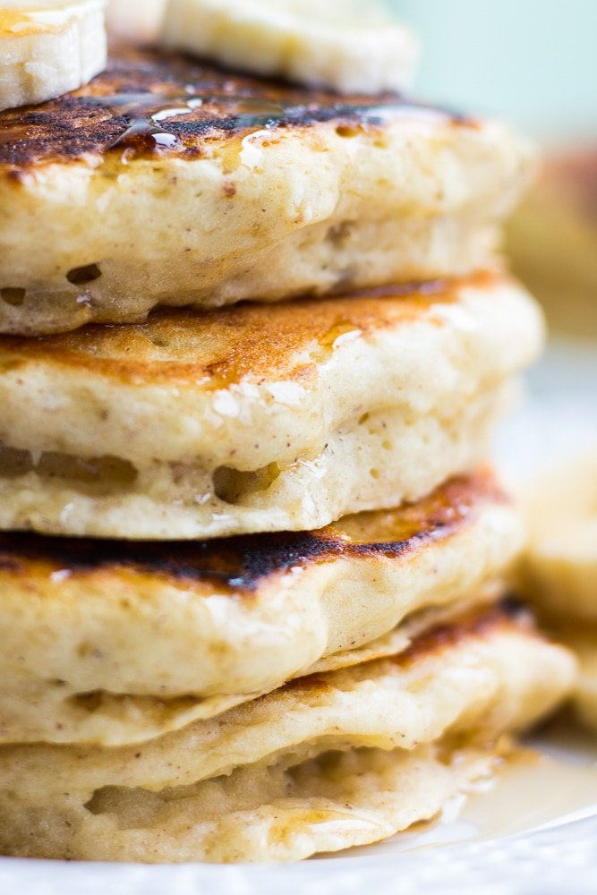super close up showing layers of fluffy vegan banana pancakes.