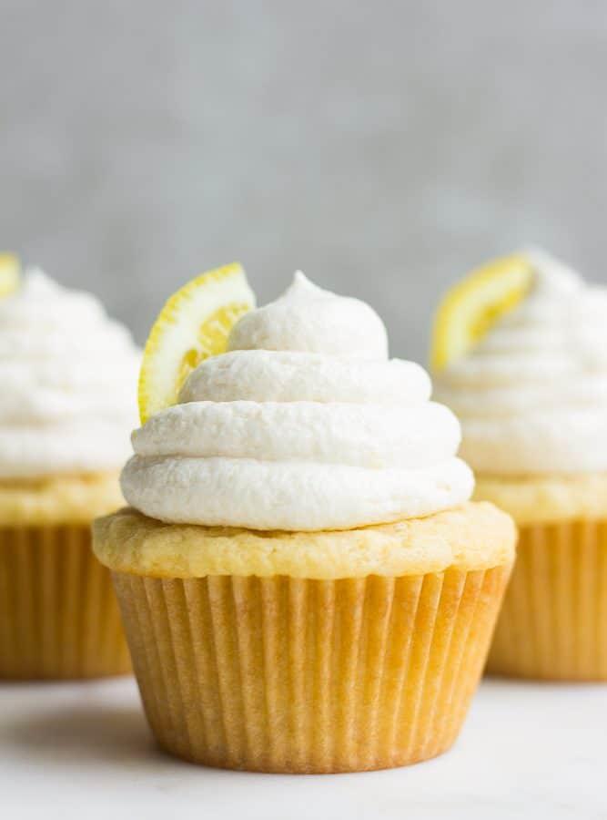 straight on photo of 3 vegan lemon cupcakes