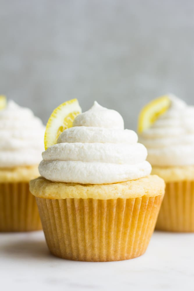 straight on photo of 3 vegan lemon cupcakes