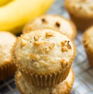 several muffins with banana in background.