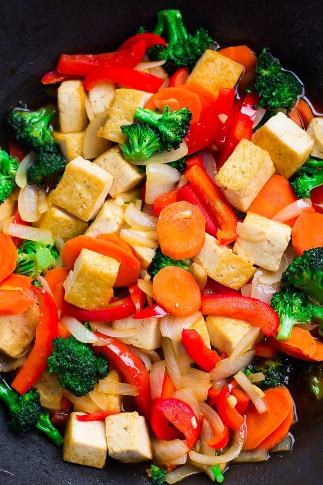 close up of tofu stir fry in a wok