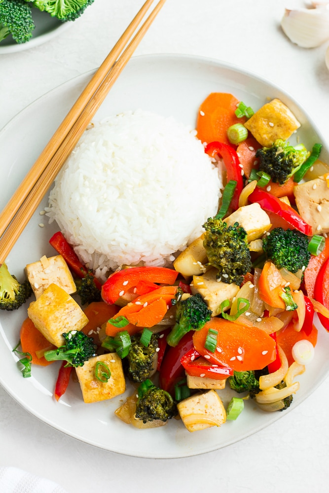 looking down on a plate of tofu stir fry with rice.