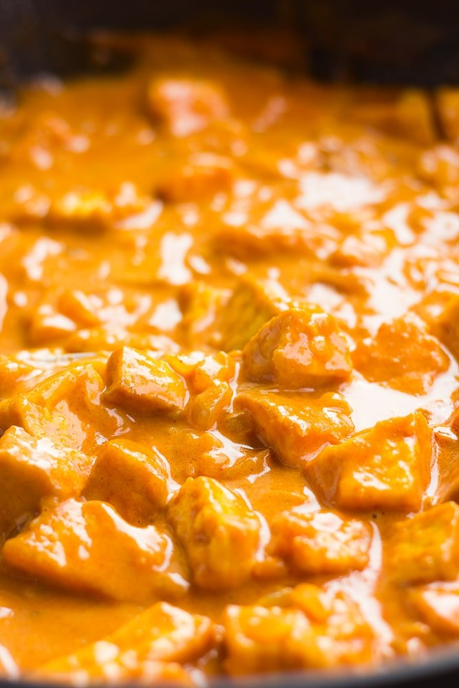 vegan butter chicken in a pan, cooked with sauce.