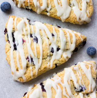 looking down on a few vegan blueberry scones with grey background