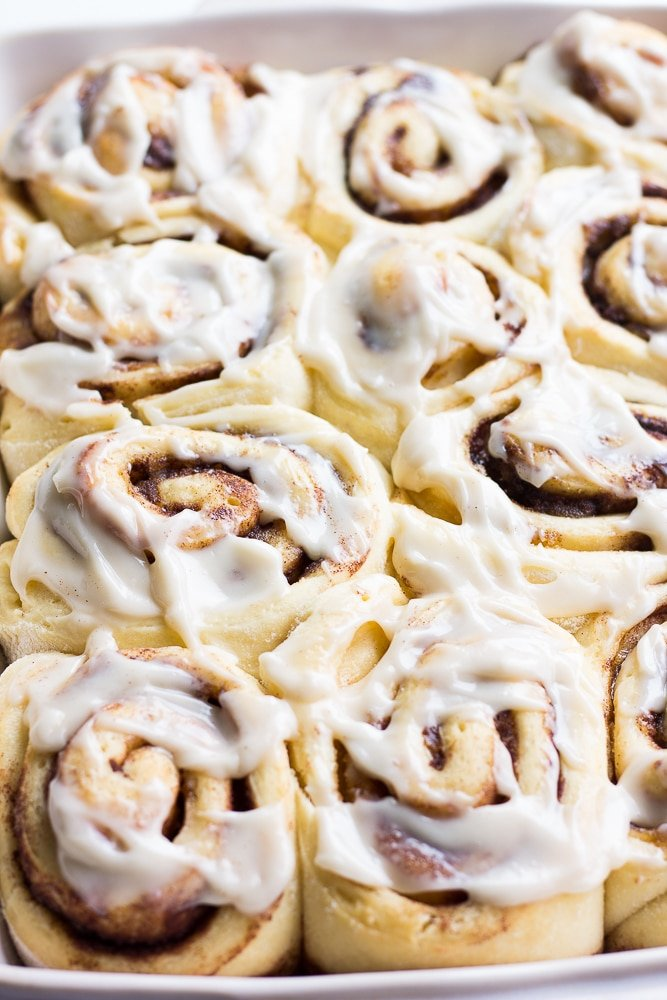 pan full of cinnamon rolls with frosting