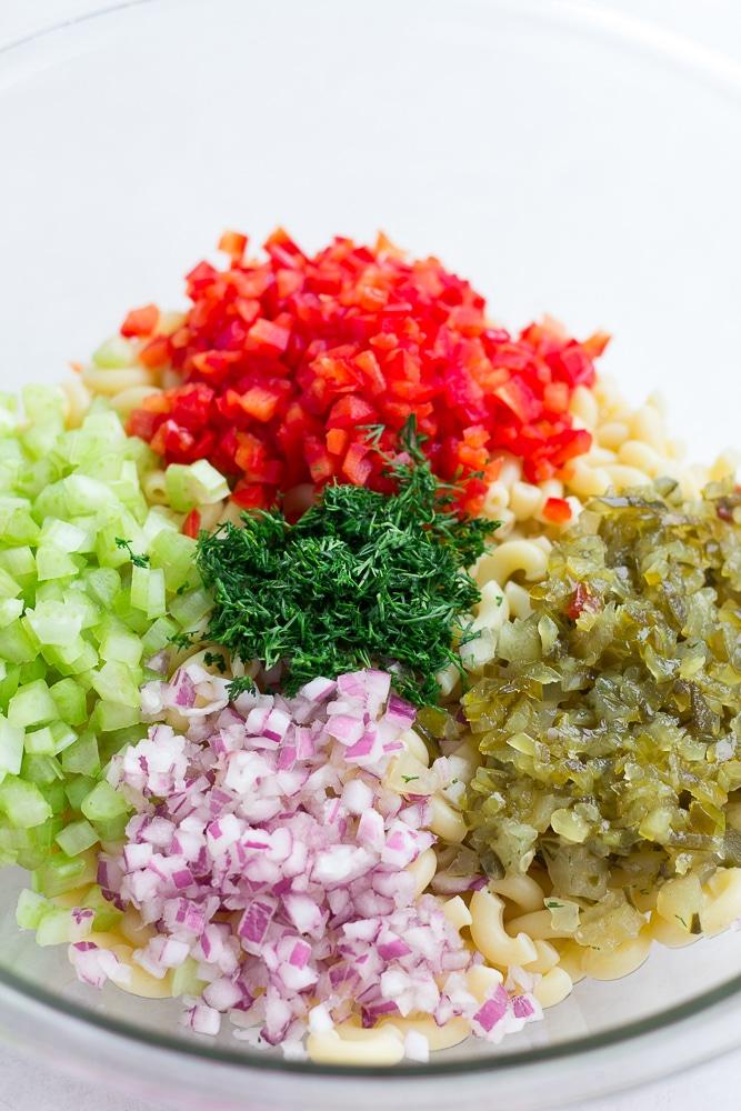 ingredients for vegan macaroni salad in bowl before mixing up.
