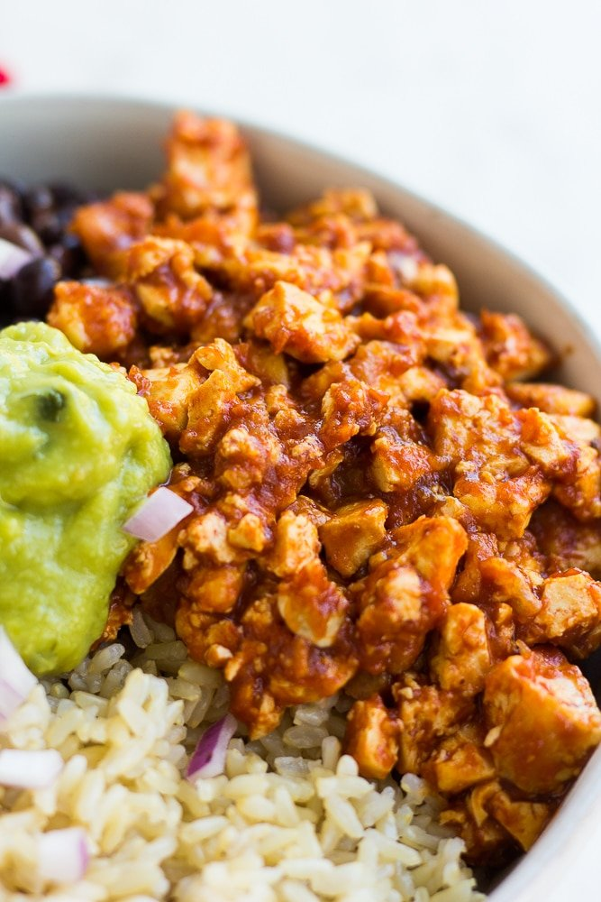chipotle sofritas recipe in a bowl with guacamole, rice and black beans.