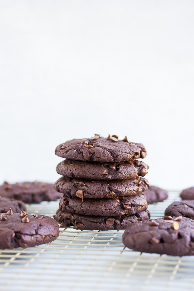 stack of vegan chocolate cookies with white background