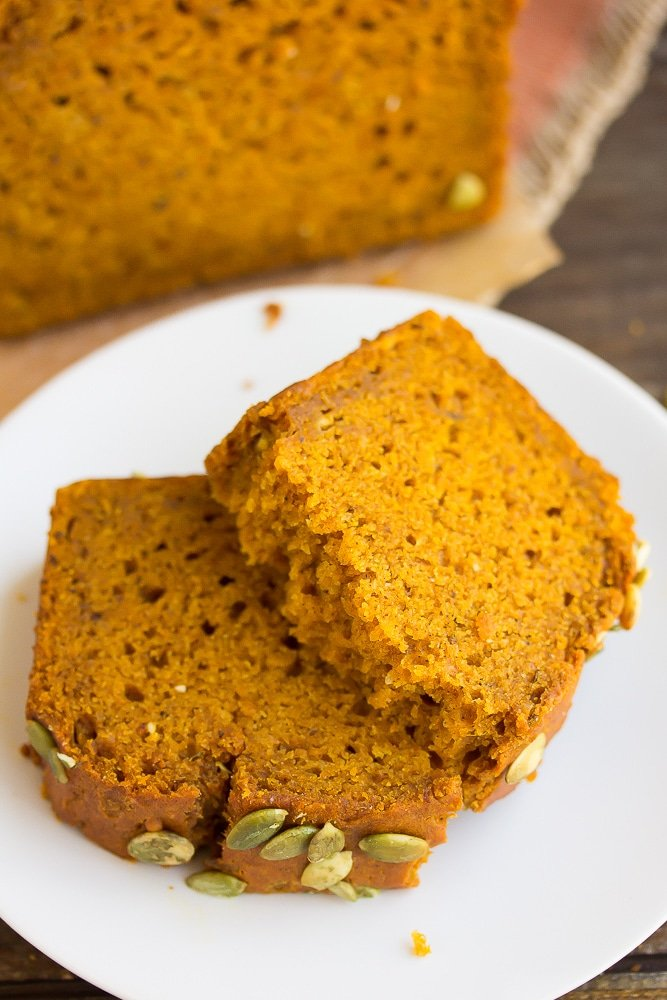 cut piece of vegan pumpkin bread showing texture