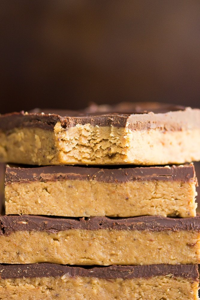 showing a close up bite of chocolate peanut butter bar