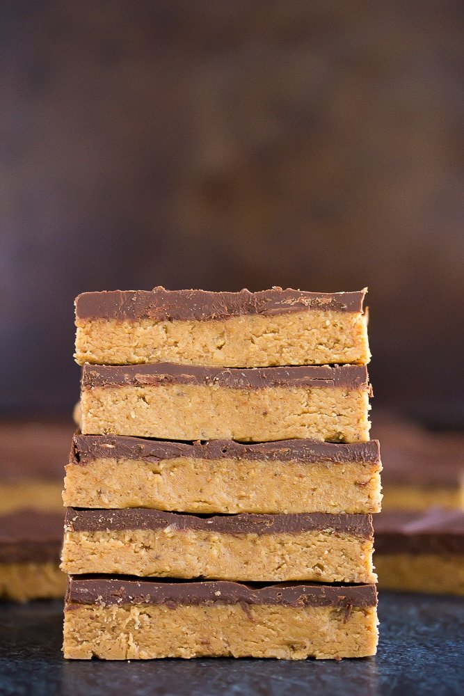 stack of vegan chocolate peanut butter bars with dark background
