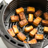 square image of tofu in a air fryer