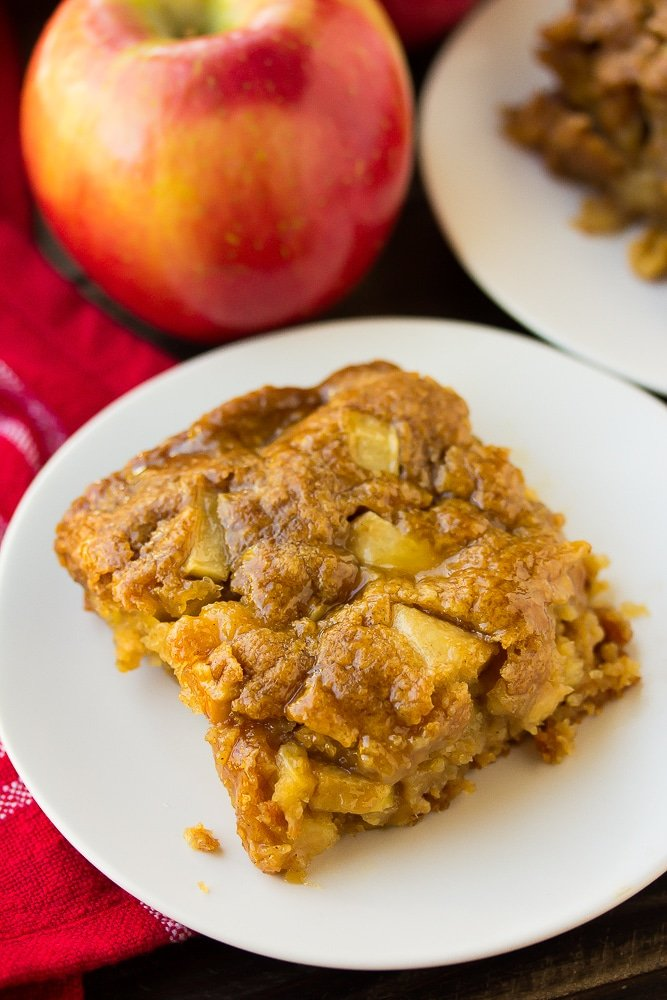 slice of vegan apple cake with apple and red towel