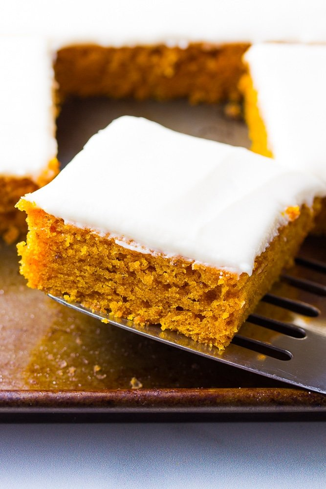 spatula taking out a piece of vegan pumpkin cake from the pan