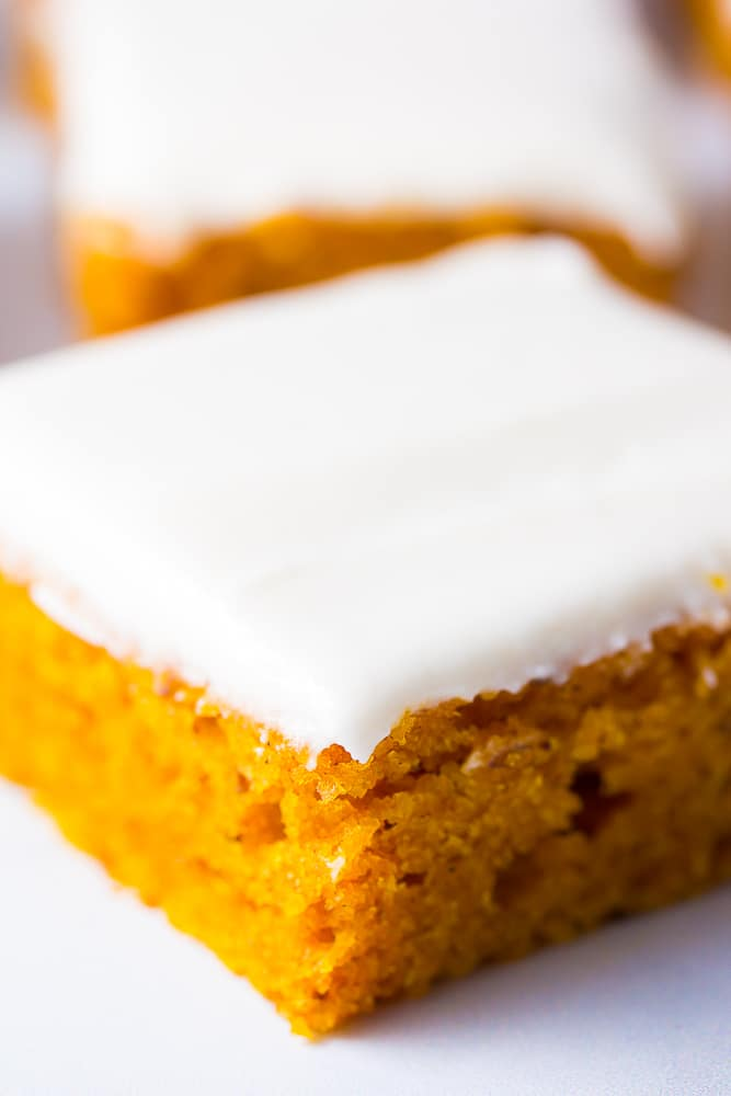 very close up of angled pumpkin cake