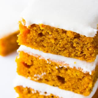 stack of 3 pumpkin bars with frosting