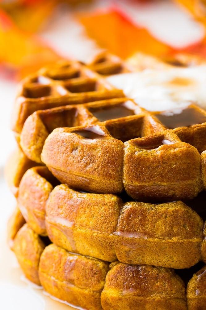 close up of vegan pumpkin waffles with cream