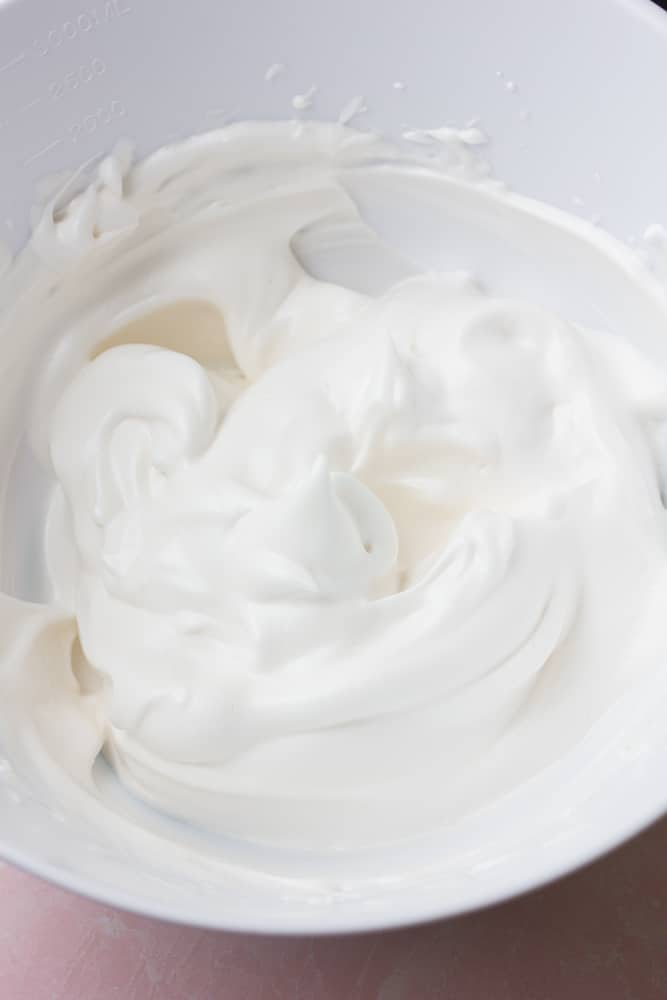 bowl of vegan whipped cream, fluffy and white