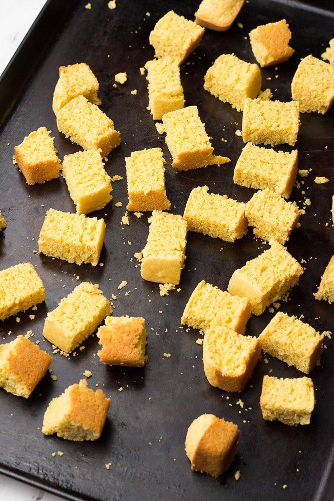 showing cubes of cornbread on a pan
