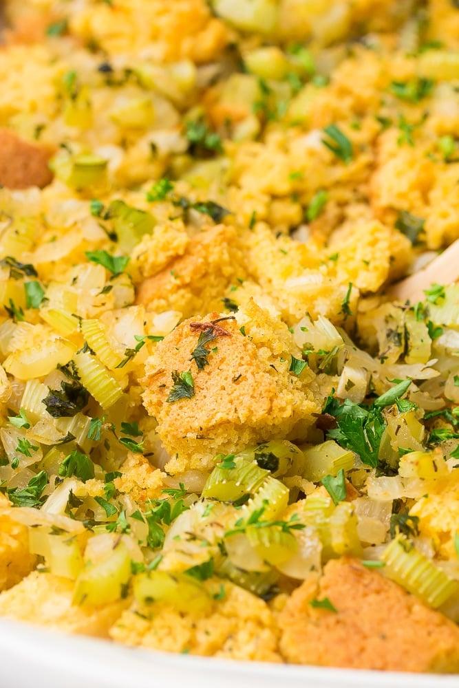 close up of vegan cornbread stuffing in a casserole dish