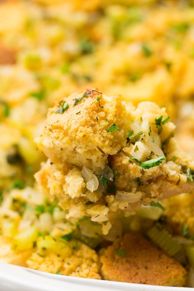 cornbread stuffing on a spoon with casserole in background