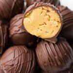 cut in half vegan chocolate peanut butter balls close up
