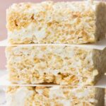 very close of shot of rice krispie treats and pink background
