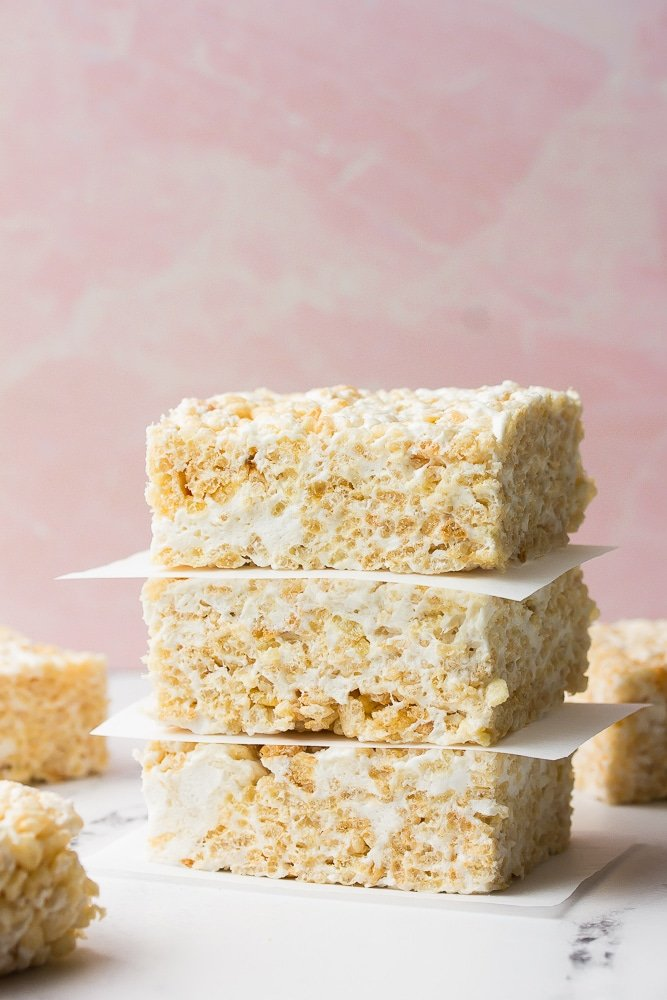 stack of rice krispie treats with pink background